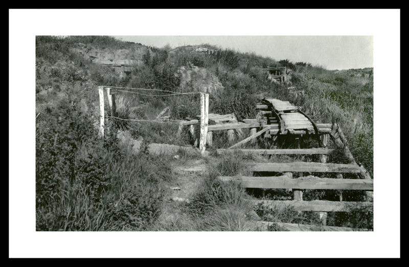 Wooded structure/ stairs with fenced in cross